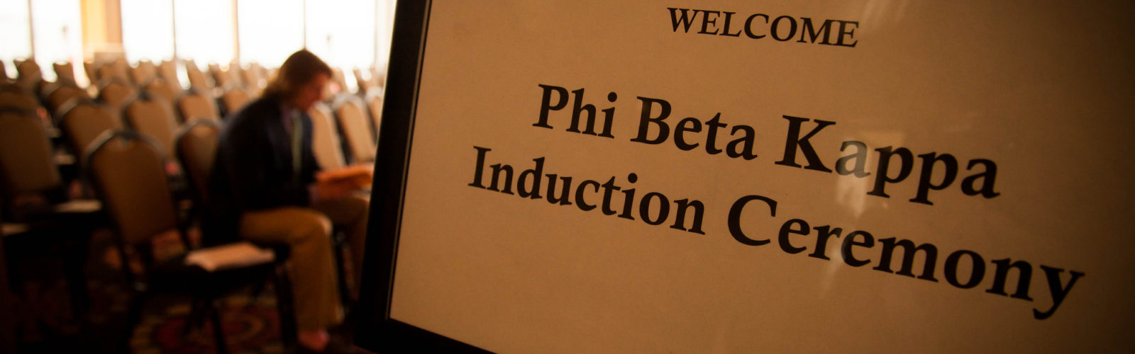 "A sign says ""Phi Beta Kappa Induction Ceremony."""