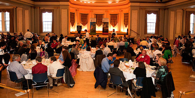 The PBK induction banquet is shown with numerous tables and people.